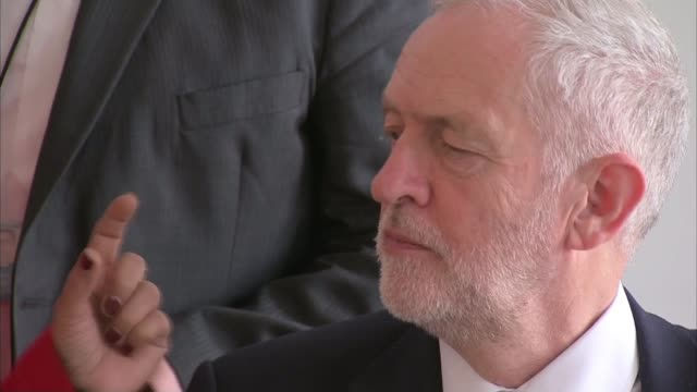 Theresa May attends EU summit BELGIUM Brussels INT Various shots of Jeremy Corbyn MP chatting to woman Jeremy Corbyn MP interview SOT The Prime...