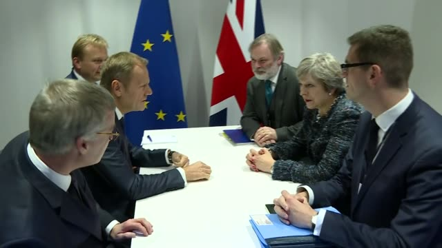 Theresa May attends EU Summit in Sweden Gothenburg INT Theresa May MP and aides seated opposide Donald Tusk at meeting table during talks