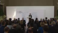 Theresa May delivers speech in Florence INT Theresa May MP arriving and along to podium David Davis MP Philip Hammond MP and Boris Johnson MP seated...