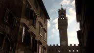 Theresa May delivers speech in Florence Low angle shot alleyway near Piazza della Signoria with Palazzo Vecchio behind General view Palazzo Vecchio...