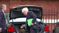 Theresa May holds cabinet meeting ahead of speech ENGLAND London EXT Boris Johnson MP from car and taking luggage from boot as replies to press...