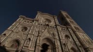 Theresa May holds cabinet meeting ahead of speech Florence EXT GVs Florence Cathedral as people past Detail on front of Cathedral building showing...