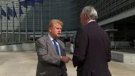 Third round of negotiations come to an end EXT EU building EU flag flying outside European Union building Reporter talking to Elmar Brok MEP Elmar...