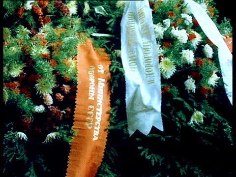 Brezhnev's burial ceremony in mortuary chapel people mourning in street coffin carried on army tank for procession