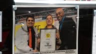 Brick lane restaurants More of Indian restaurants and signs outside / Ainsley Harriot in photograph with winner of 'Taste Brick Lane curry awards' /...