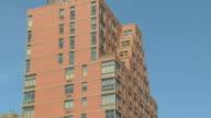 TU brick loft apartment building with water tower / New York, New York, USA