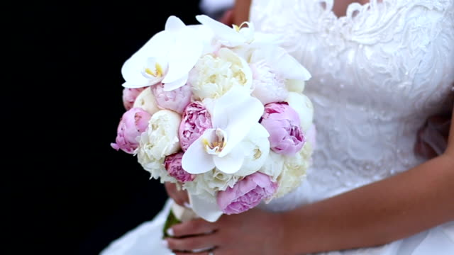 Bridal bouquet of roses and tulips