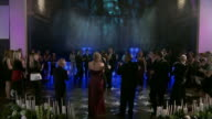 TILT UP Bride and groom and wedding party dance in center of ring of clapping guests
