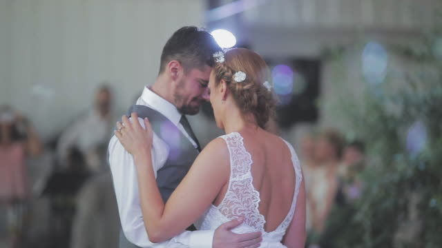 Bride and groom dancing together their first dance
