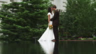 WS TU Bride and groom kissing by pond / Salt Lake City, Utah, USA