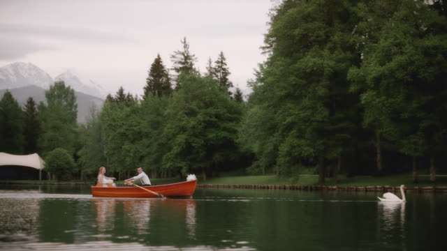 Bride and groom riding in a rowing boat