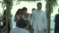 MS, CS, Bride and groom walking down aisle after wedding ceremony, beach of Cabo San Lucas, Mexico