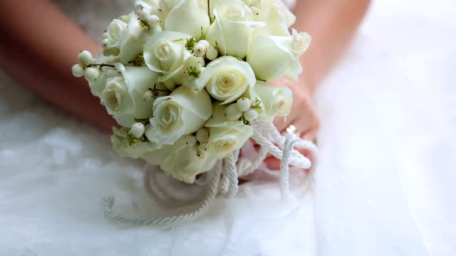 bride holds her beautiful bouquet