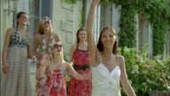 SLO MO, MS, Bride throwing bouquet, Chateau du Parc, Saint Ferme, France