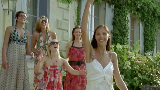 SLO MO, MS, Bride throwing bouquet, Chateau du Parc, Saint Ferme, France
