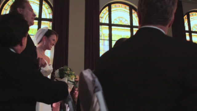 TS, bride walks down aisle with father