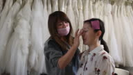 Bridetobe Echo Li is getting ready for a prewedding photography shoot on October 11 2016 in London England It's a Chinese custom for couples to have...