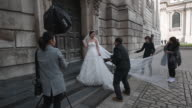 Bridetobe Echo Li poses during a prewedding photography shoot at St Paul's Cathedral on October 11 2016 in London England It's a Chinese custom for...