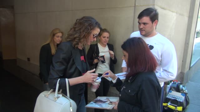 Bridget Moynahan at the TODAY show signs for fans on September 17 2014 in New York City