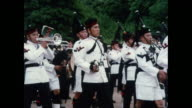 MONTAGE Brigade of Gurkhas playing bagpipes and marching in Scotland / United Kingdom