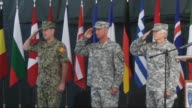 Brigadier General Christopher Petty leaves his position to US Brigadier General Giselle Wilz at the NATO headquarters in Sarajevo Bosnia and...