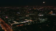 AERIAL Bright moon above the illuminated MGM Tower and business district / Los Angeles, California, United States