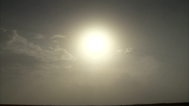 A bright sun shines in a hazy sky. Available in HD
