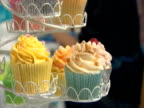 Brightly coloured cupcakes on a stand