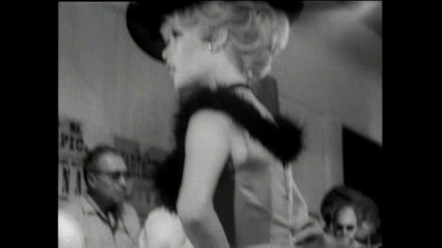 Brigitte Bardot backstage preparing for her role in Viva Maria Alain Delon visits the set Checking costume hair and makeup