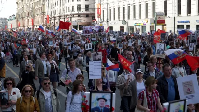 Brimming with pride and clutching portraits of relatives more than 500000 Russians flooded central Moscow on Saturday to commemorate 70 years since...