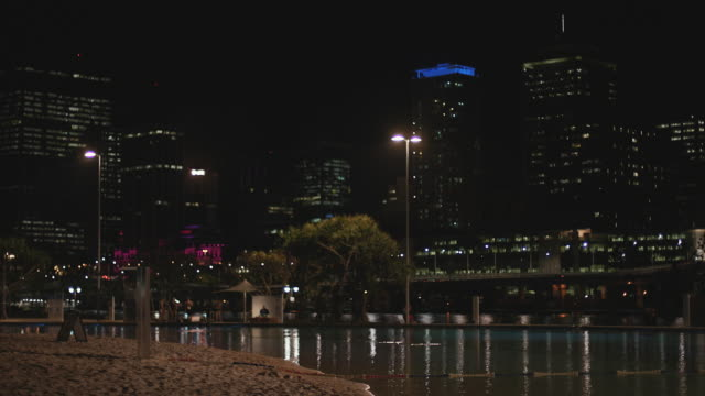 Brisbane CBD with the river and artificial city beach at night
