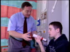 Britain has highest number of asthma sufferers ITV EVENING NEWS MARTIN GEISSLER Edinburgh Asthma sufferer putting inhaler to his mouth pressing...