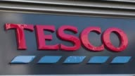 Britains biggest retailer supermarket group Tesco says it has fallen into a net loss during its first half partly on costs linked to an accounting...