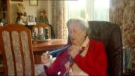 Britain's longestserving Girl Guide Badges attached to Alder's chest and showing medal Joanne Alder interview SOT