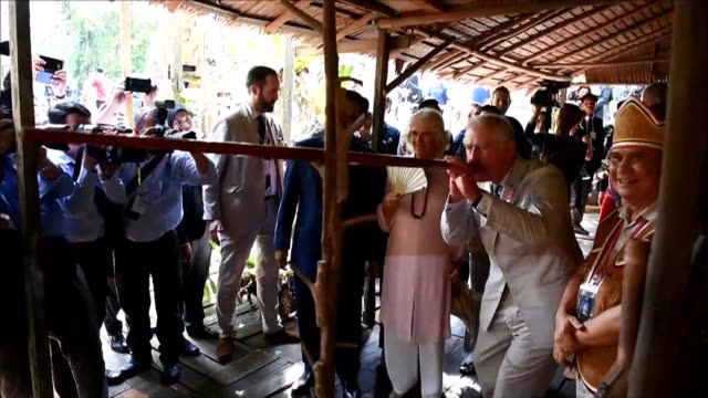 Britain's Prince Charles and his wife Camilla meet tribal leaders and watch a traditional dance as they visit the island of Borneo as part of a royal...