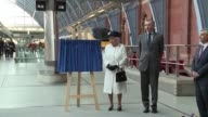 Britains Queen Elizabeth unveiled a plaque at St Pancras International train station on Thursday to mark the 20th anniversary of the opening of the...