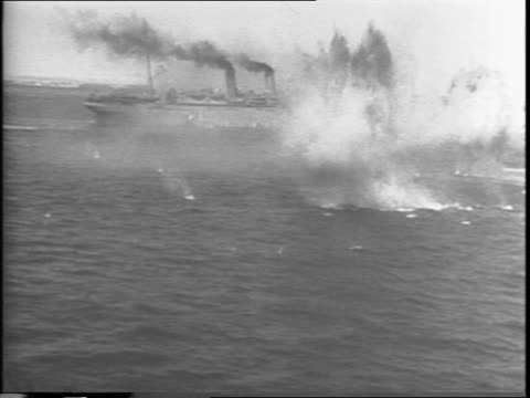 Britian's 8th Army under General Bernard Law Montgomery lands more reinforcements in Sicily / explosion and smoke / convoy of ships in distance /...