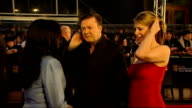 British Academy Film and Television Awards red carpet arrivals Ricky Gervais and partner Jane Fallon posing for press and signing autographs/ Ricky...
