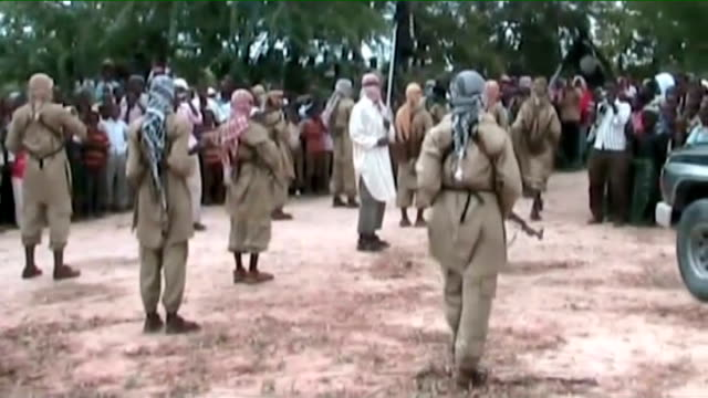British aid worker kidnapped 2112009 Various of armed Al Shabaab militants in streets and waving to crowds at parade