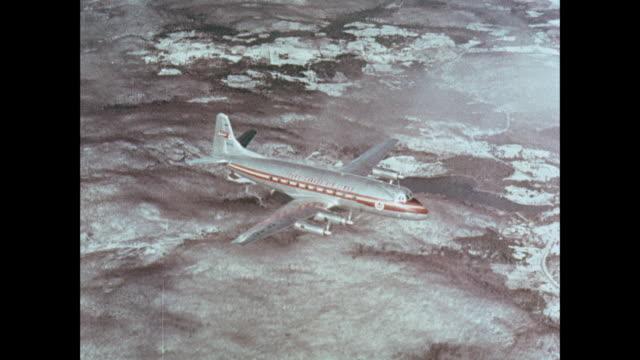 MONTAGE British airplane flying in sky / United Kingdom