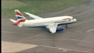 picket line / BA planes Close up of British Airways plane taxiing along PULL OUT BA plane runway / AIR VIEW BA plane as lands on runway PULL OUT