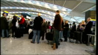 British Airways CEO refuses bonus March 2008 Heathrow Airport Terminal 5 INT Passengers queueing at checkin desks during delays
