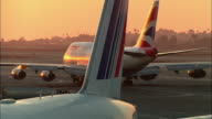 MS, British Airways jet taxiing on runway at sunset, Los Angeles, California, USA