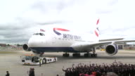 British Airways staff greet the airlines' first A380 at Heathrow as it arrives after its inaugural flight from Toulouse A crowd of staff wave flags...