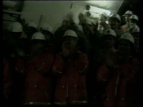 British and French construction workers meeting up in the Channel Tunnel / English Channel