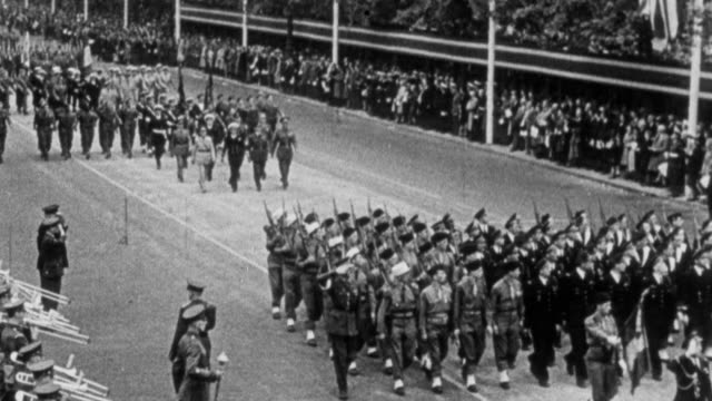 MONTAGE British Army and armies of the Commonwealth marching in parade before the royal family in 1945 / London, England