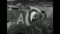 A British attack on Victoria Air Base in Burma during World War II causes damage to storage drums airplanes cars and a radio transmission station