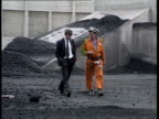 Profits EXT Yorks Haworth GV Colliery PAN LR CMS Stack of coal as Stephen Cape and miner Nigel Roberts around PAN LR CMS Nigel Roberts intvwd SOF I...