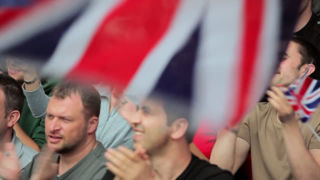 British flag waving and supporters clapping
