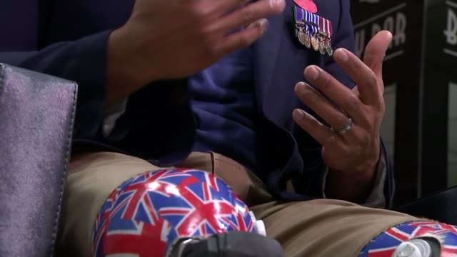British football bosses lobby FIFA to be allowed to wear poppies to mark Armistice Day ENGLAND London INT Derek Derenalagi sitting during interview...
